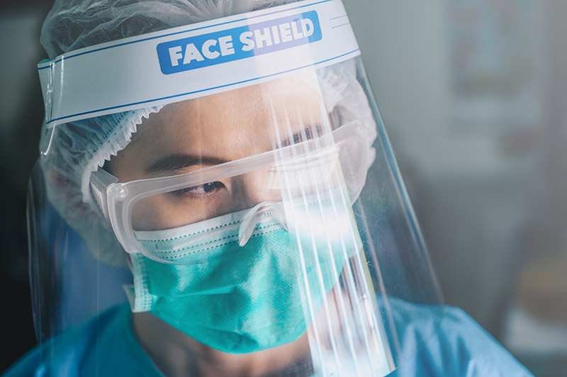 nurse-wearing-face-shield-and-mask
