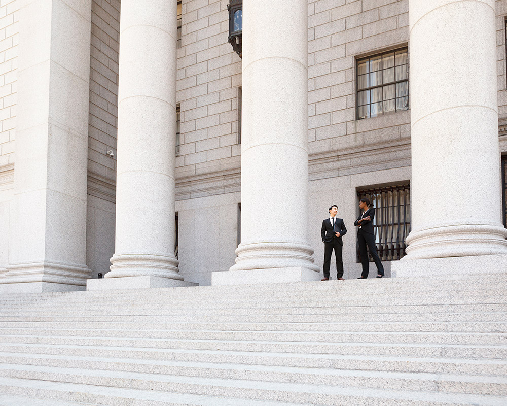 two-business-men-on-steps