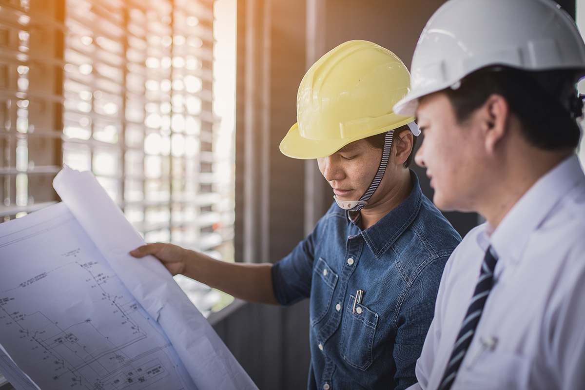 two-contractors-going-over-plans
